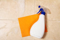Spray bottle is on a orange sponge Royalty Free Stock Photo