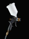 Spray gun shot over black background Royalty Free Stock Photography