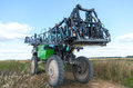 Sprayer self propelled in a lithuanian field Royalty Free Stock Photo
