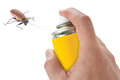 Spraying insecticide on cockroach Royalty Free Stock Photo