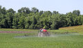 Spraying a soybean feild vehicle pesticides onto field Stock Images