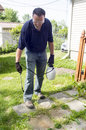 Spraying Weed Killer On A Patio Royalty Free Stock Photo