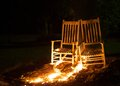 Spreading fire rocking chairs on with the flames out Royalty Free Stock Photography