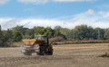 Spreading lime fertilizer onto a farm field Royalty Free Stock Photo
