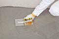 Spreading self leveling compound with trowel Stock Photography