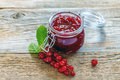 Sprig of red currants and a jar of homemade jam. Royalty Free Stock Photo