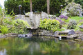 Spring American Northwest home water pond with landscape garden Royalty Free Stock Photo