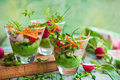 Spring appetizer with raw vegetables and green pea hummus Stock Image
