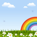 Spring background with rainbow green grass flowers clouds and swallows useful also as easter greeting card Stock Photos