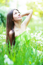 Spring beauty girl beautiful young woman lying on green grass outdoor park meadow summer on the field happiness Royalty Free Stock Photos