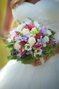 Spring bouquet bright wedding in the hands of the bride Royalty Free Stock Images