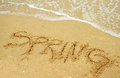Spring break a warm tropical beach for concept and written in the sand Stock Photos