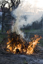 Spring cleaning burning the remains from autumn Royalty Free Stock Photo