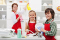 Spring cleaning in the kitchen family and washing dishes Stock Image
