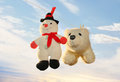 Spring cleaning toy polar bear and snowman hanging on a rope and drying off after washing on the background of a gentle sky Stock Photography