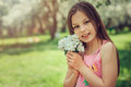 Spring closeup outdoor portrait of adorable 11 years old preteen kid girl