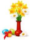 Spring colorful flowers in a vase with Easter eggs Stock Image