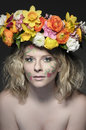 Spring is coming portrait of a young woman with like make up and a colorful flower wreath in her hair Stock Photos