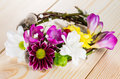 Spring composition with willow twigs wreath and fresh flowers on