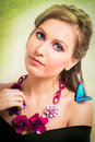 Spring concept of a blonde woman with a blue butterfly and a flo Royalty Free Stock Photo