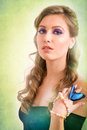 Spring concept of a blonde woman with a blue butterfly on her ha Royalty Free Stock Photo