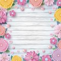 Spring design of colorful flowers and hearts on wood background