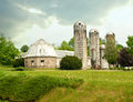 Spring farm landscape with stone barn and silos on a overcast day Stock Photography