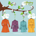 Spring  Fashion .Woman coats hang on a branch Royalty Free Stock Photo