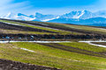 Spring fields snow in the tatra mountains on slovakia behind Royalty Free Stock Image