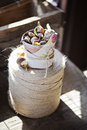 Spring flower bulbs in ceramic pot wrapped in fabric on twine
