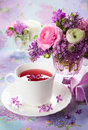 Spring flowers beautiful in vase and cup of tea Royalty Free Stock Image