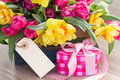 Spring flowers with gift box and empty tag Royalty Free Stock Photo