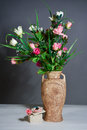 Spring flowers in a vase on grey background
