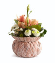 Spring flowers in wicker vase isolated Royalty Free Stock Images