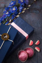 Spring gift with candy and flowers on a blue stone background Royalty Free Stock Photo