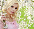 Spring Girl with Cherry Blossom. Beautiful Blonde Young Woman Royalty Free Stock Photo