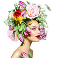 Spring girl with flowers beauty hair style Royalty Free Stock Photo
