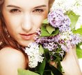 Spring girl with lilac flowers portrait of a beautiful Royalty Free Stock Images