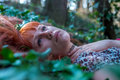 Spring girl lying on the field of ivy Royalty Free Stock Photo