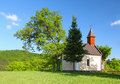 Jarní krajina s kaplí na Slovensku