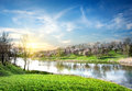 Spring landscape with river the and the sun Royalty Free Stock Image