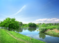 Spring landscape with the river on a sunny day Stock Images