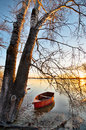 Spring landscape with wooden boat Stock Images