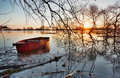 Spring landscape with wooden boat on a flooded river early Royalty Free Stock Images