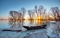 Spring landscape with wooden boat on a flooded river early Stock Image