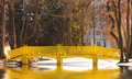 Spring landscape with yellow bridge over a lake Stock Images