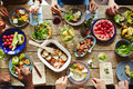 Spring nosh up people having a rich dinner with fresh vegetables and homemade meal Royalty Free Stock Photo