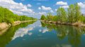 Spring panoramic landscape with small river Royalty Free Stock Photo