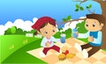 Spring picnic boy and girl sitting under a tree Stock Image