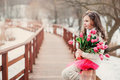 Spring portrait of child girl with tulips bouquet on the walk Royalty Free Stock Photo